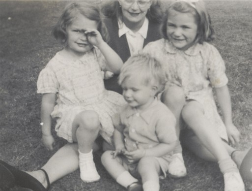 Photo:Gladys (left) sits with her family