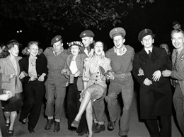 Photo:'Knees Up Mother Brown' had been sung on the streets of London at the Armistice in 1918.  Celebrating VE Day, 8th May 1945, a cockney 'knees up' of epic proportions demanded athe song made an appearance.