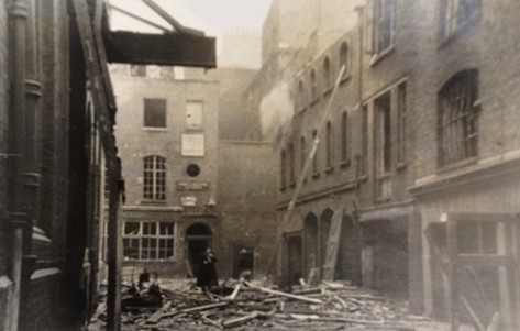 Photo:Bomb damage to a mason yard, Duke Street, February 1944